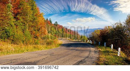 Old Serpentine Road In Mountains. Beautiful Autumn Scenery On A Sunny Day. Trees In Colorful Foliage