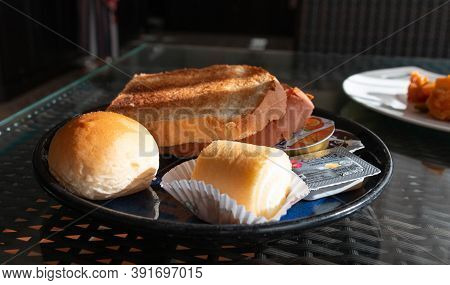 Nakhon Ratchasima, Thailand- September 5, 2020: Traditional Slices Of Bread, Bun, Jam Roll And Butte