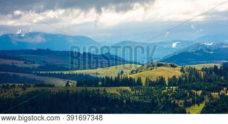 Beautiful Scenery Of Mountainous Countryside. Clouds Above The Hills Rolling In To The Distant Valle