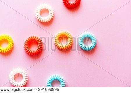 Multicolored Spiral Hair Ties On A Pink Background. Hair Accessory.
