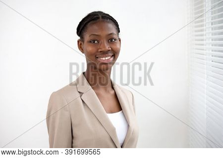 Portrait of beautiful african american business woman against a window.