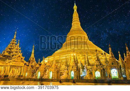 Shwedagon is the most sacred golden buddhist pagoda in Myanmar. Yangon, Myanmar. Beautiful sky full of stars