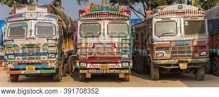 Varanasi, India - November 06, 2019: Panorama Of Three Colorful Indian Trucks In Rajastan, India