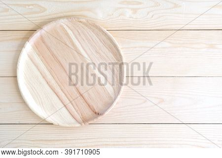 Empty Round Wooden Tray On Wood Table Background, For Product Display Montage, Flat Lay, Top View
