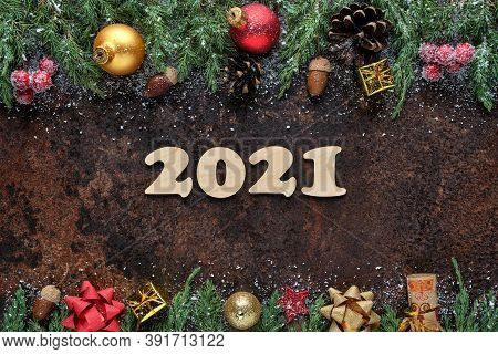 Christmas Or New Years Eve Festive Background With Wooden Numbers 2021 And Christmas Decorations On
