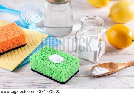 Organic Cleaners. White Vinegar, Lemon And Sodium Bicarbonate On White Background.