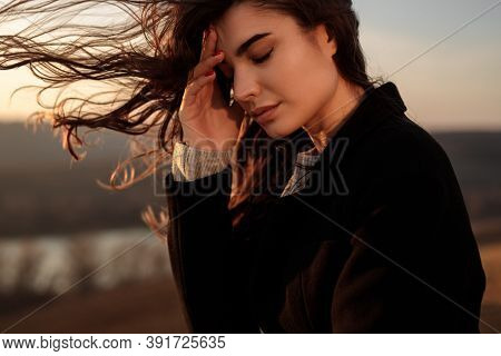 Side View Of Exhausted Lonely Young Female With Long Hair Fluttering In Wind Having Problems And Thi