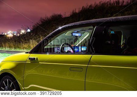 Prague, Czech Republic - October 26, 2020. Night Photo Of Interior Through The Window With Dashboard