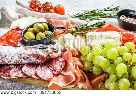 Antipasto Set Platter. Cold Smoked Meat Plate With Sausage, Sliced Ham, Prosciutto, Bacon, Olives. A