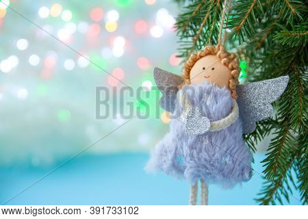 Soft Light Christmas Background, Close-up Of A Soft Angel With Wings On A Christmas Tree On A Light