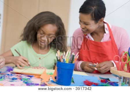 Teacher And Student In Art Class (Selective Focus)