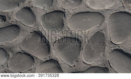 The Texture Of The Traces Of Huge Gray-brown Cobblestones In The Medieval Pavement In The Old City.