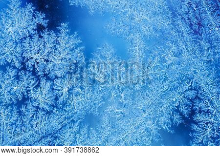 Abstract Ice Flowers Pattern, Frosted Window Macro View Background. Cold Winter Weather Xmas Backdro