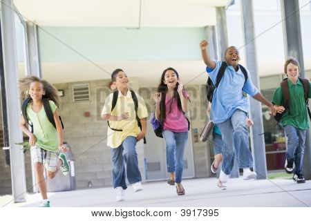 Six students running away from front door of school excited poster
