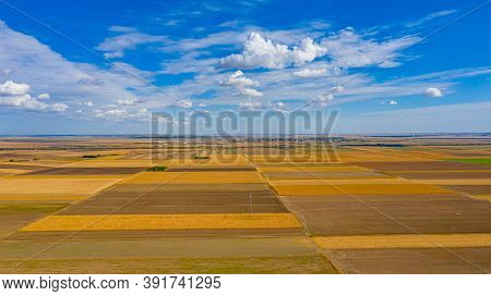 Above View Over Agricultural Fields, Cultivated Plots In Harvest Season, Beautiful Blue Sky With Whi