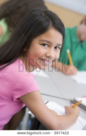 Student In Class Looking At Camera (Selective Focus)
