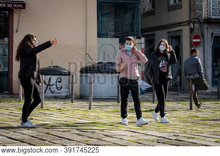 Porto, Portugal - October 26, 2020: Young Girls Wearing A Face Mask During The Covid-19 Pandemic. Th
