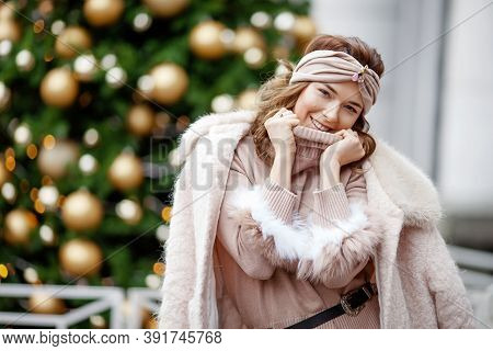 Outdoor Portrait Of Young Beautiful Happy Smiling Girl Posing On Street Against Background Of Decora