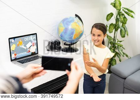 Video Contest. Little Beautiful Girl With Long Dark Hair Making Little Video Presentation While Part
