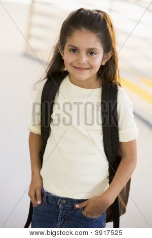 Student Standing Outdoors Smiling (High Key)