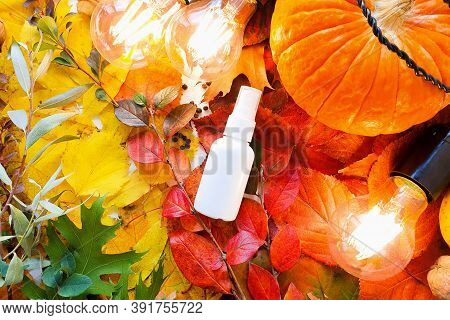 Mock-up Of White Plastic Spray Bottle Pumpkin, Magic Lights And Bright Autumn Leaves. Atmospheric Fa