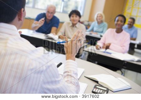 Teacher In Class Lecturing Adult Students (Selective Focus)