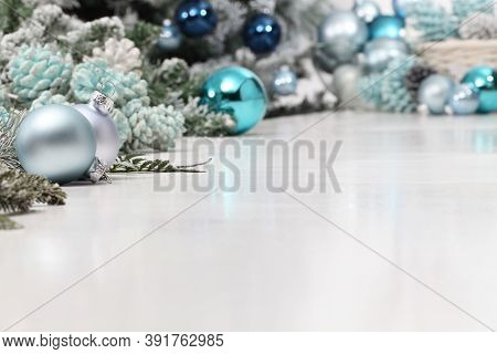 Merry Christmas Background, Silver And Blue Christmas Balls And Pine Cones Decorations On White Tabl