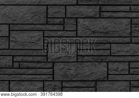 Block Pattern Of Black Stone Cladding Wall Tile Texture And Seamless Background