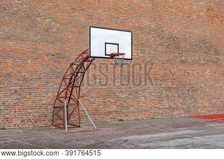 Basketball Hoop Sport Court At Brick Wall