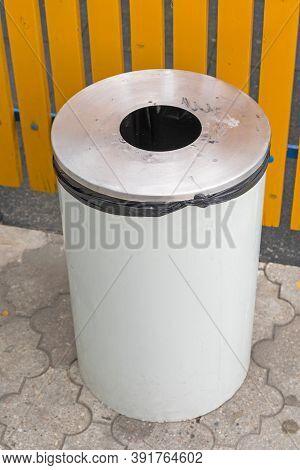 Big White Garbage Bin At Pavement Street