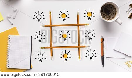 Creative Ideas Competition. Tic-tac-toe Of Lightbulbs On White Office Desk Background. Creativity, N
