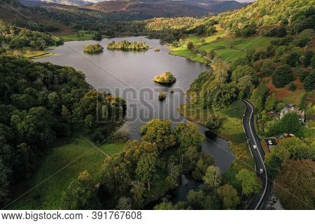 An Aerial Landscape By Drone Of Rydal Water Lake Towards Grasmere In The Lake District National Park