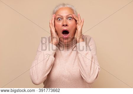 Amazed Elderly Woman Looking Surprised And Shocked.