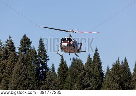Prospect,  Oregon / Usa - September 9, 2014:  A Fire Fighting Helicopter Pilot Looks Out His Window