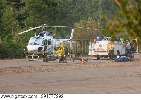 Prospect,  Oregon / Usa - September 13, 2014:  A Fire Fighting Crew Gets Some Exercise On The Runway