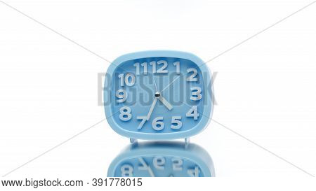Blue Clock With Arabic Numerals Rotating On Isolated White Background. Clock Minute Arrow Walks Slow