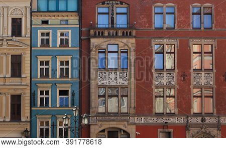 Facades Of Residential Building In The Center City Wroclaw. Old Tenement House With Windows, Row Of