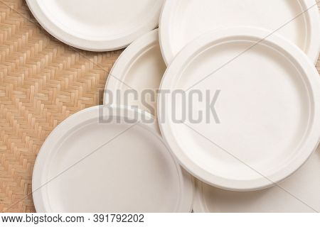 Biodegradable Plate, Compostable Plate Or Eco Friendly Disposable Plate On Woven Bamboo Background,