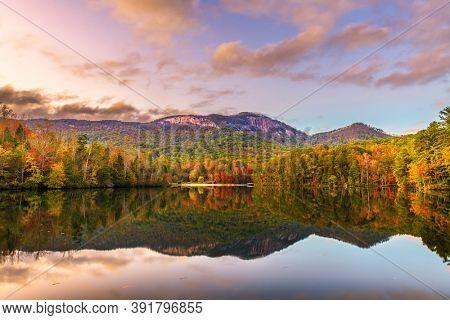 Pinnacle Mountain, Pickens, South Carolina, USA lake view in autumn at dusk.