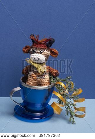 Toy Bull Symbol Of 2021 In Blue Cup On Blue Background