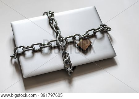 Laptop Surrounded By Chain With Padlock For Digital Detoxification. Cenital Plane.