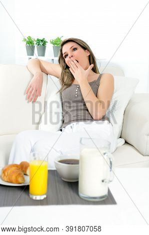 Woman Is Liying In Her Sofa, She Is  Leasing, Before Having Breakfast