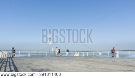 Hermosa Beach Usa - October 7 2015; People Relaxing, Fishing Walking On Hermosa Pier On Clear Summer