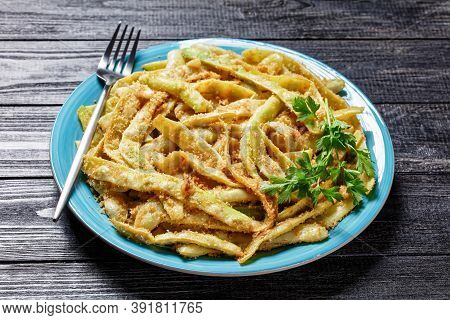 Golden French Low-calorie Wax Beans With Garlic And Parsley Coated With Breadcrumbs And Fried On A S