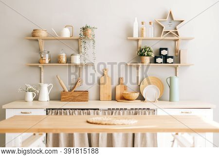 Bright Kitchen In The Provence Style With Houseplants, Wooden Dishes And Kitchen Accessories On The