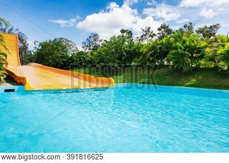 yellow water slides in tropical aqua park