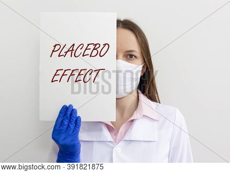 Placebo Effect Concept Inscription. Doctor Hands Showing Paper Close Up.