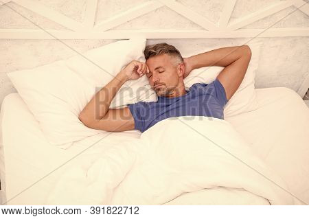 Breathe Easily, Sleep Well. Handsome Man In Bed. Sleeping Guy At Home. Relaxed Man. Promote Preventi