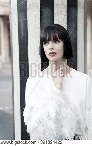 Girl With Brunette Hair Hairstyle In Paris, France. Woman With Red Lips, Makeup Face At Striped Colu