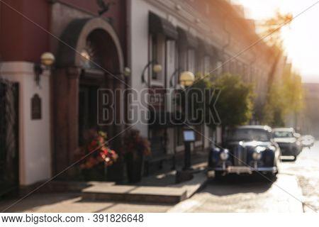 Blurry Old Retro Car On Empty City Street